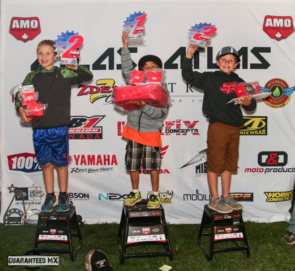 50cc 7-8 Sponsored by 100%: 3rd Hudson Reed, 2nd Riley Reed, and AMO Champ Ben Kongmany